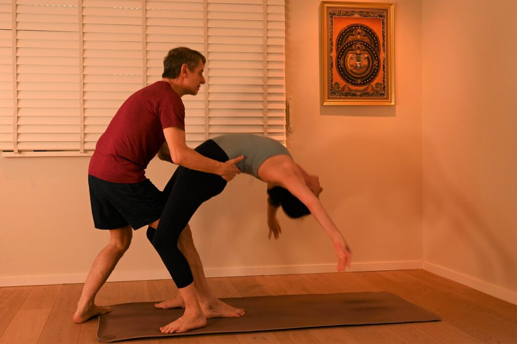 woman doing yoga meditation on brown parquet flooring